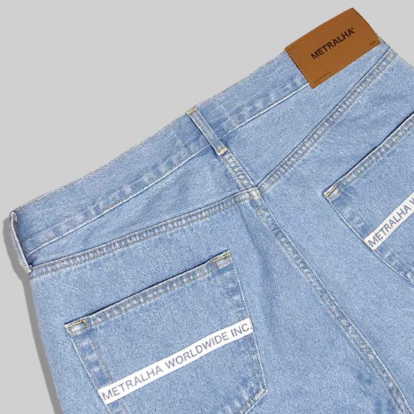 metralha-worldwide-light-blue-jeans-reflective-detail-back-pocket-online-store